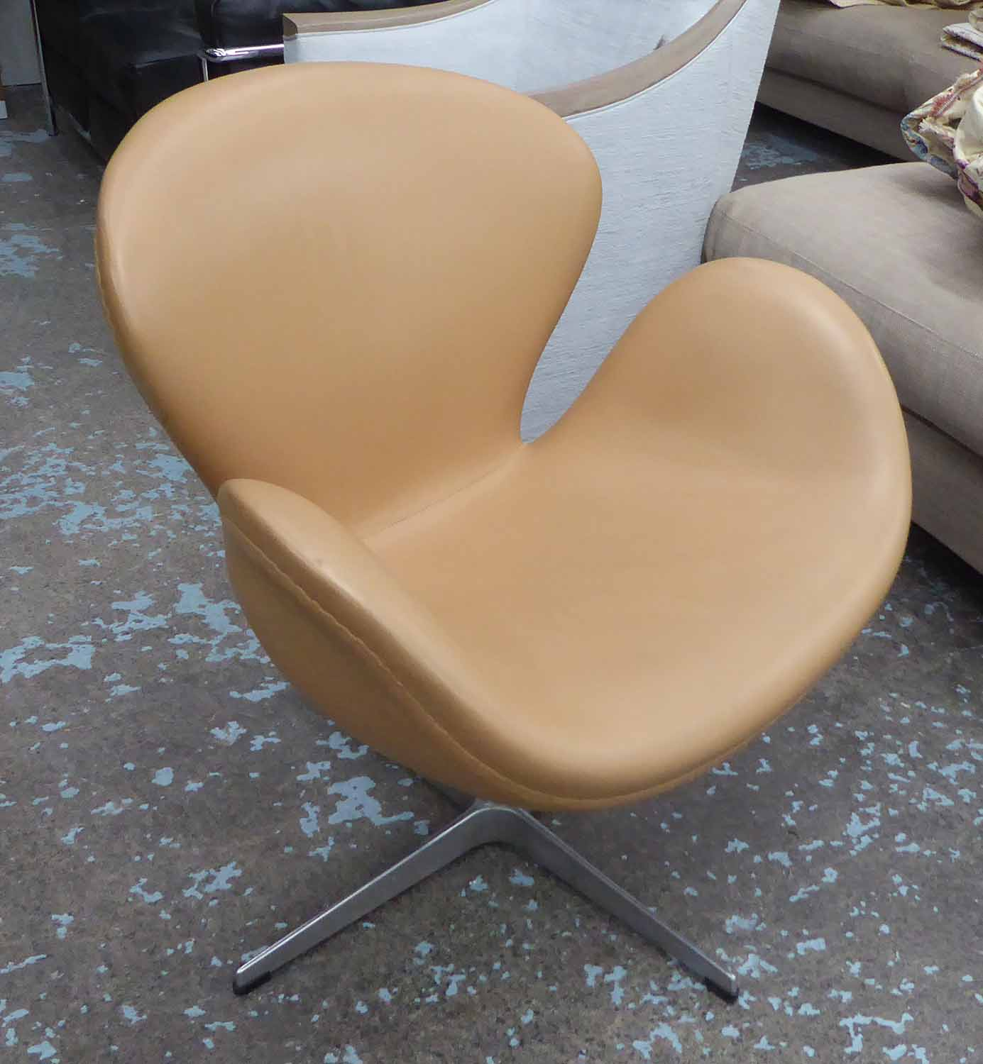 Lot 5 - SWAN STYLE SWIVEL CHAIR, caramel coloured leather, 72cm W.