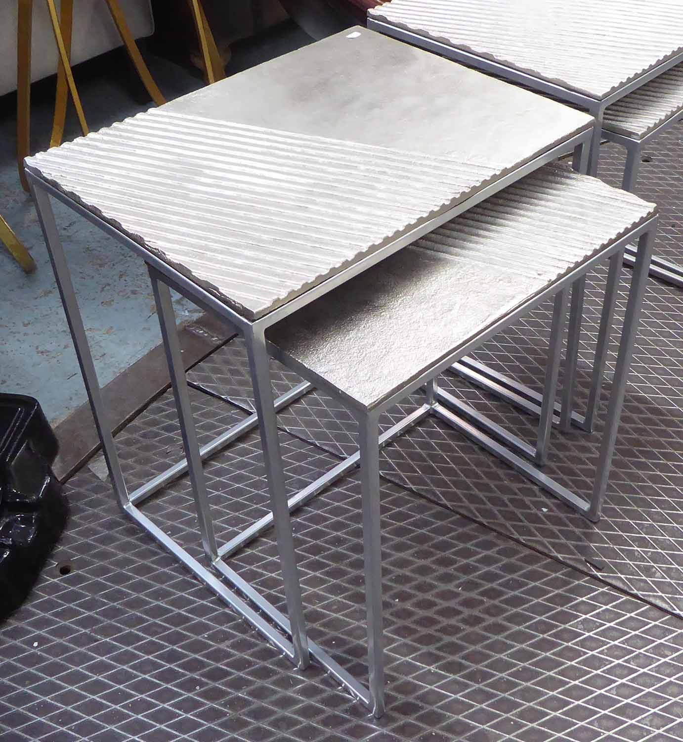 Lot 16 - NEST OF TWO TABLES, in silver painted finish on metal supports, 46cm x 36cm x 53cm H.