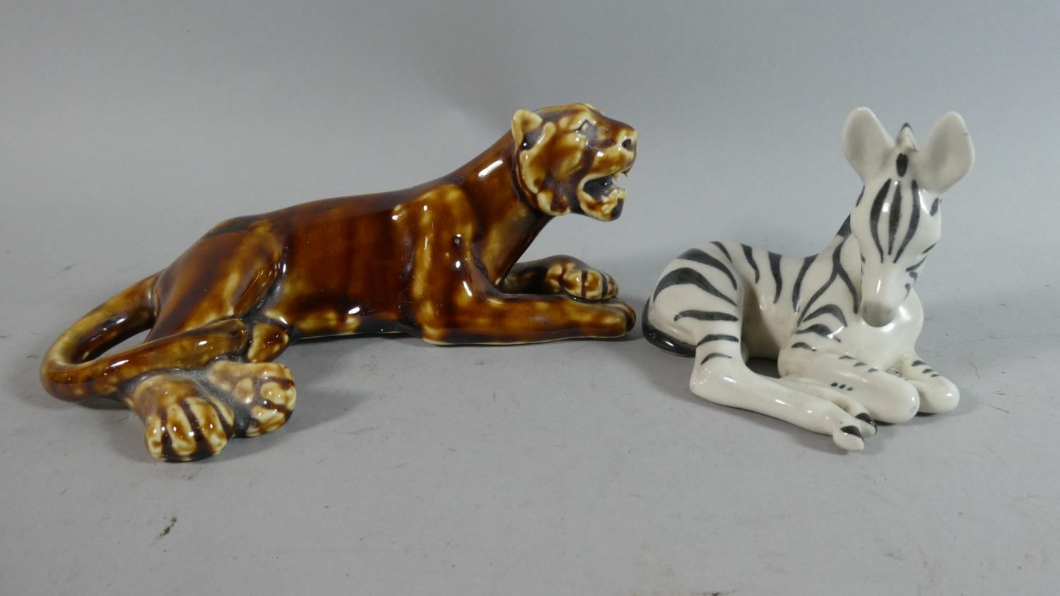 Lot 240 - Two Russian Ceramic Animal Figures, Recumbent Lion and Recumbent Zebra
