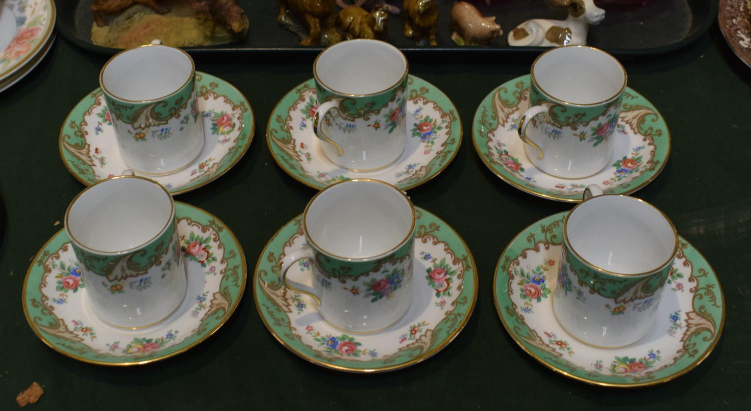 Lot 230 - A Set of Six Tuscan Coffee Cans and Saucers