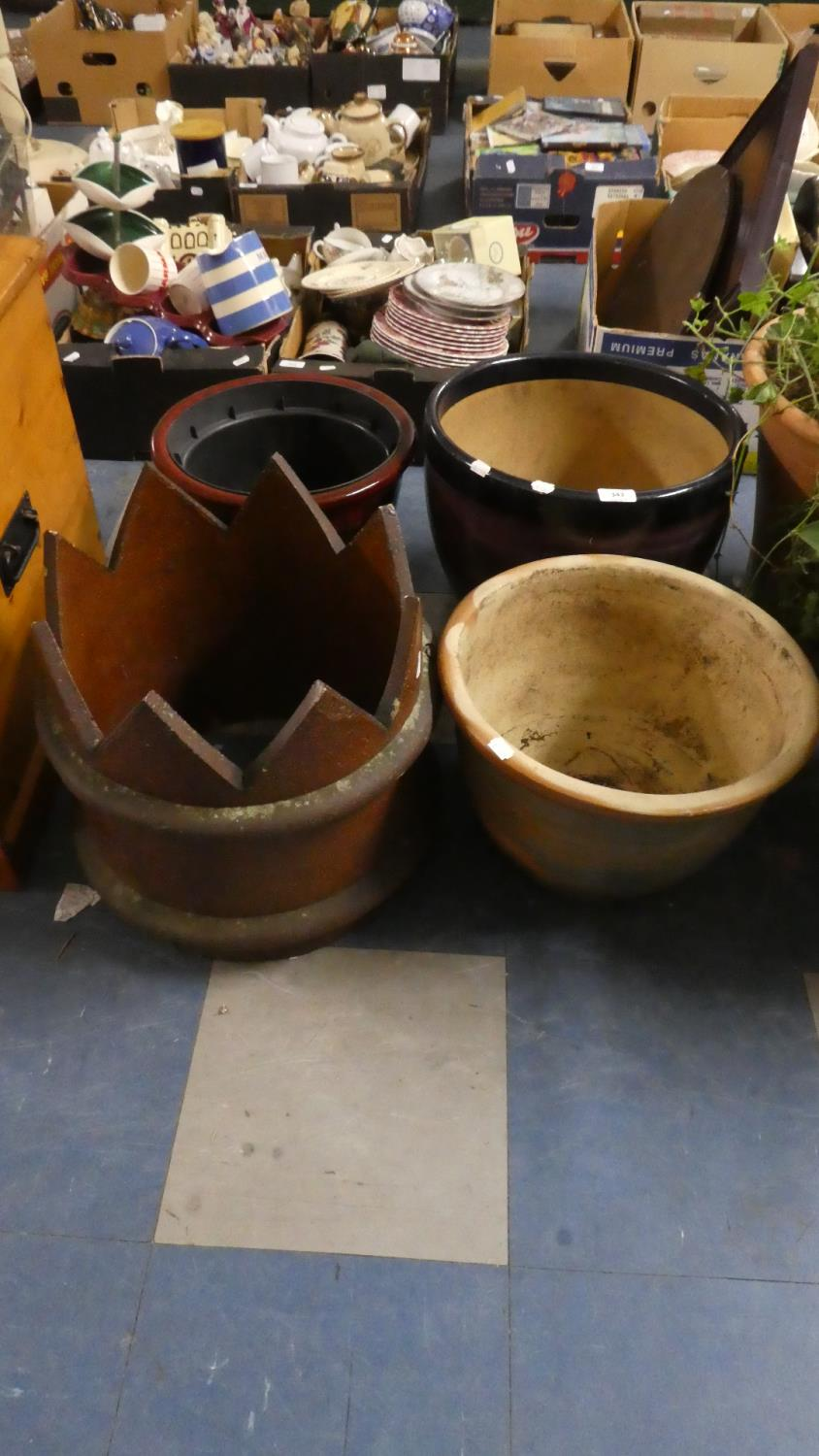 Lot 343 - Three Glazed Ceramic Patio Planters and a Treacle Glazed Castellated Chimney Pot Top