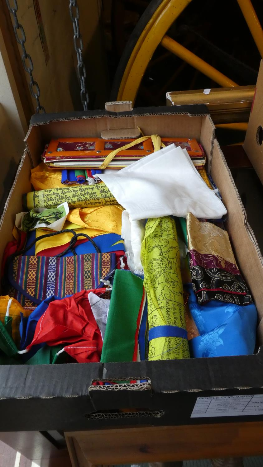 Lot 322 - A Box Containing Colourful Buddhist Prayer Flags, Panels and Fabrics