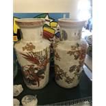 A pair of white and orange oriental vases