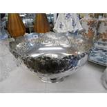A large silver plated punch bowl with lion head handles