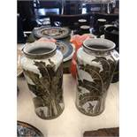 A pair of art deco style hand painted porcelain vases
