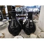 A pair of blue ground oriental vases