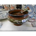 A Victorian glazed stoneware bowl with hallmarked silver rim (Sheffield 1879) and matching servers