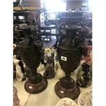 A pair of bronze cherub vases