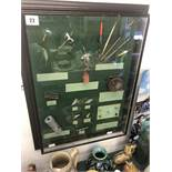 A framed fishing diorama