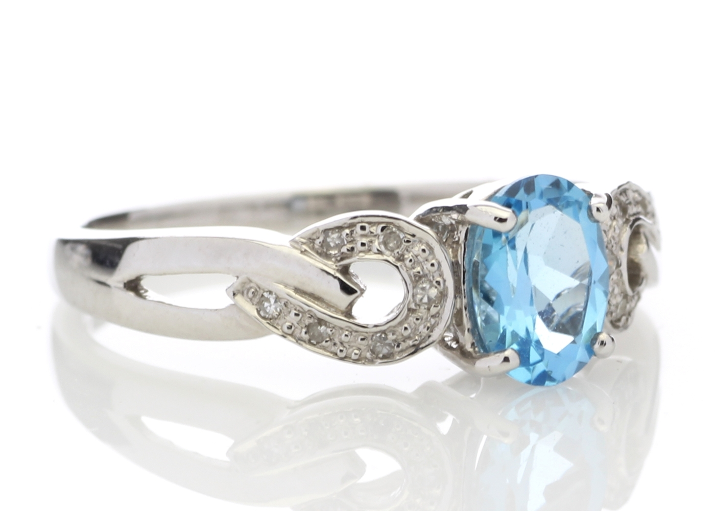 Lot 44 - 9ct White Gold Diamond And Blue Topaz Ring 0.05