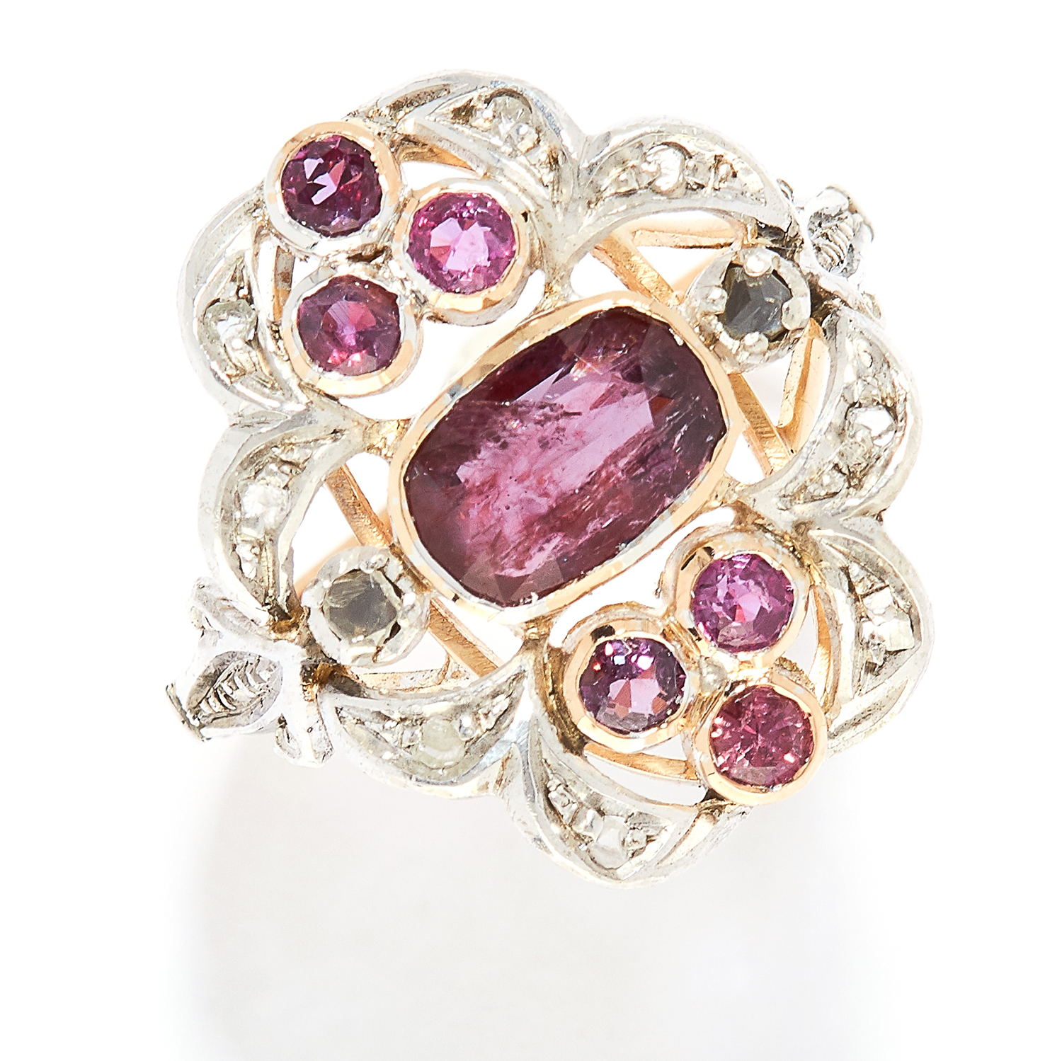 GARNET AND DIAMOND RING in yellow gold, in open scrolling design set with oval and round cut garnets