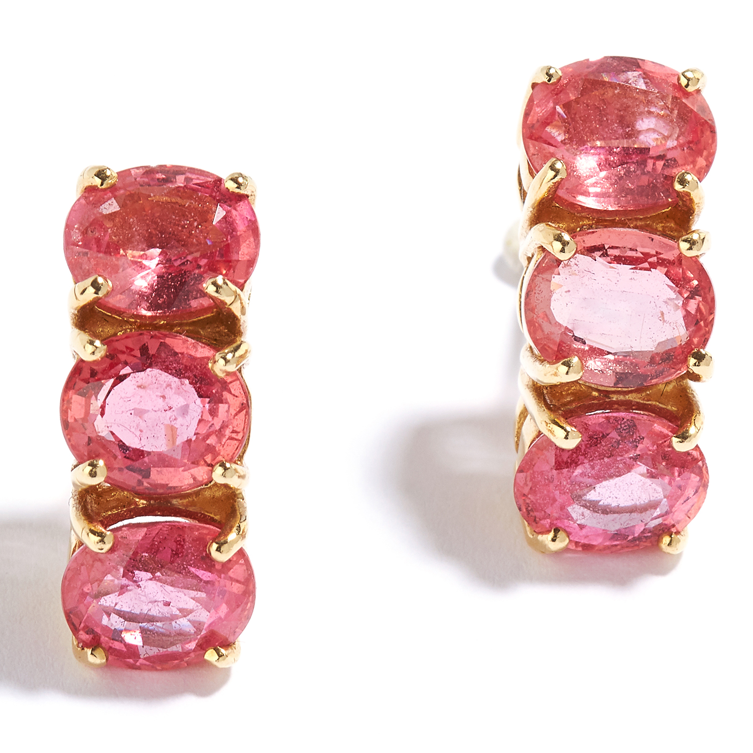 PADPARADSCHA SAPPHIRE EARRINGS in high carat yellow gold, each designed as a quarter hoop set with a