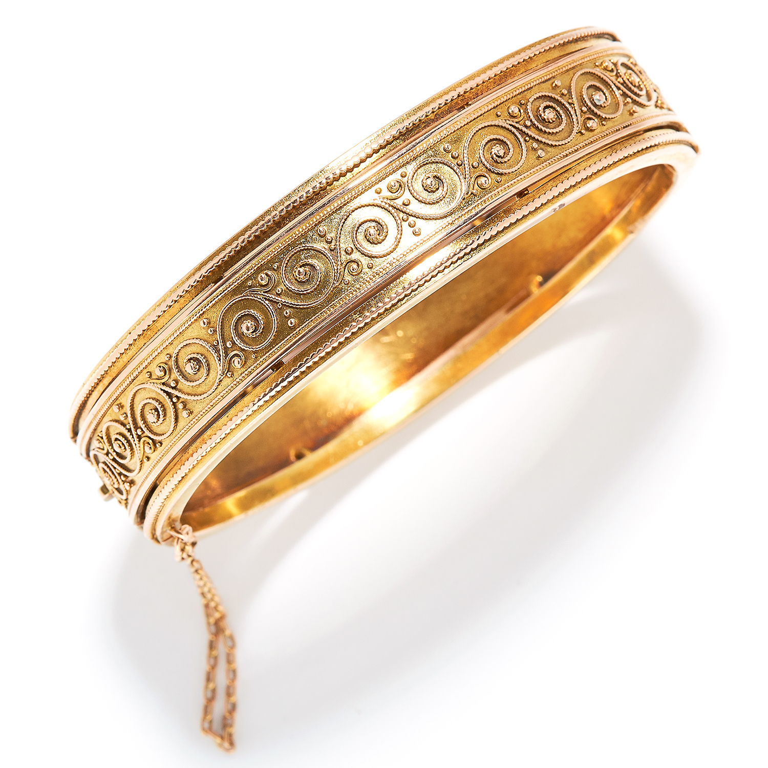 GOLD BANGLE, CARL BACHER in yellow gold, Etruscan revival manner with scrolling wirework designs,