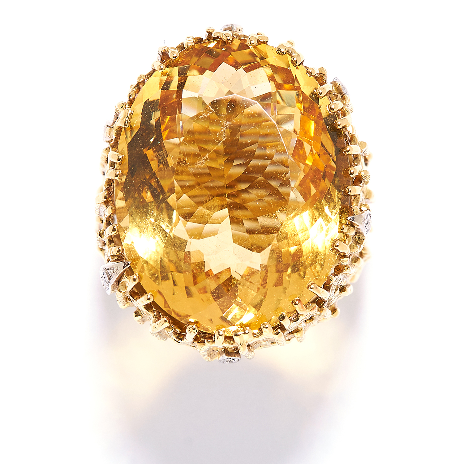 CITRINE AND DIAMOND RING, GRIMA, CIRCA 1972, in 18ct yellow gold, set with an oval cut citrine in