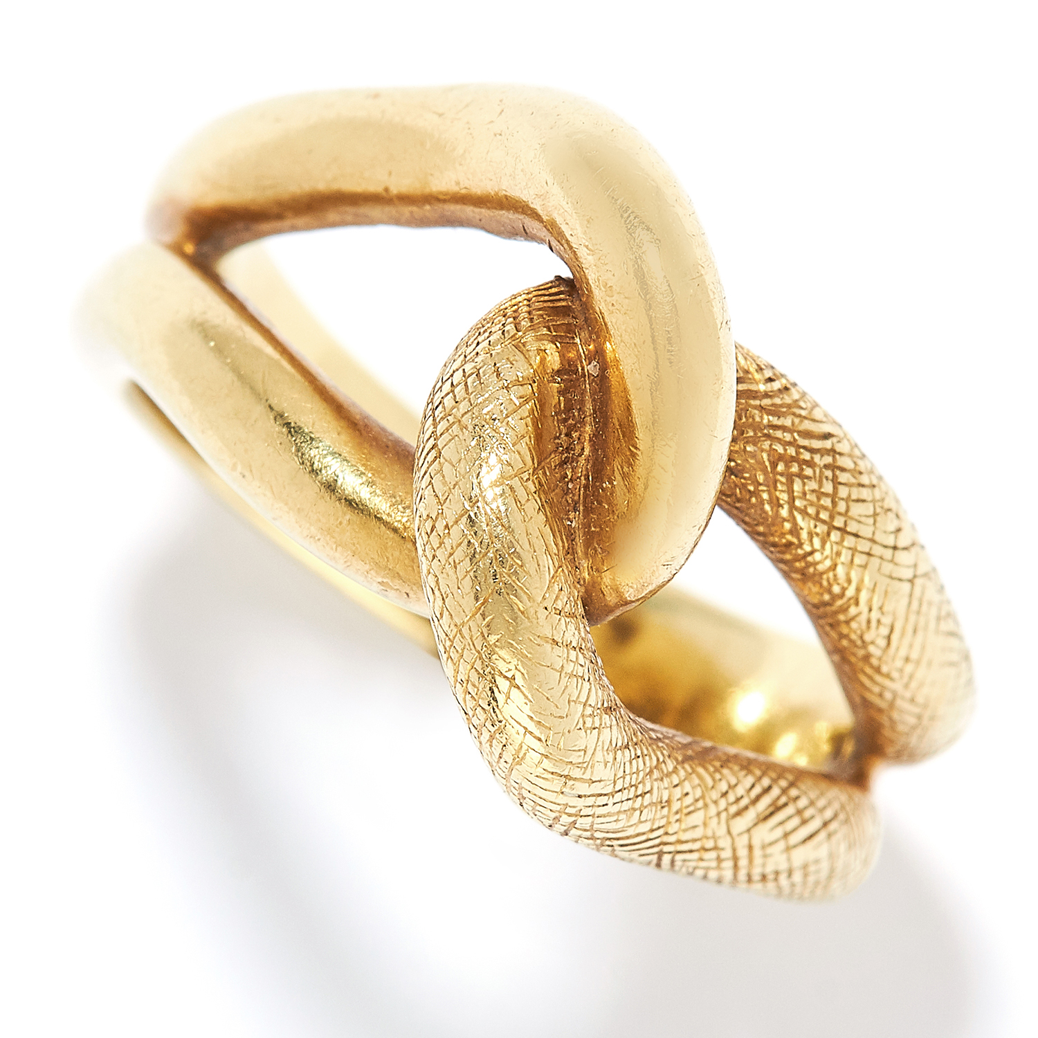 KNOT RING, TIFFANY AND CO in 18ct yellow gold, depicting a textured open knot, signed Tiffany &