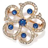 ANTIQUE SAPPHIRE AND DIAMOND BROOCH in high carat gold, in open scrolling motif set with rose cut
