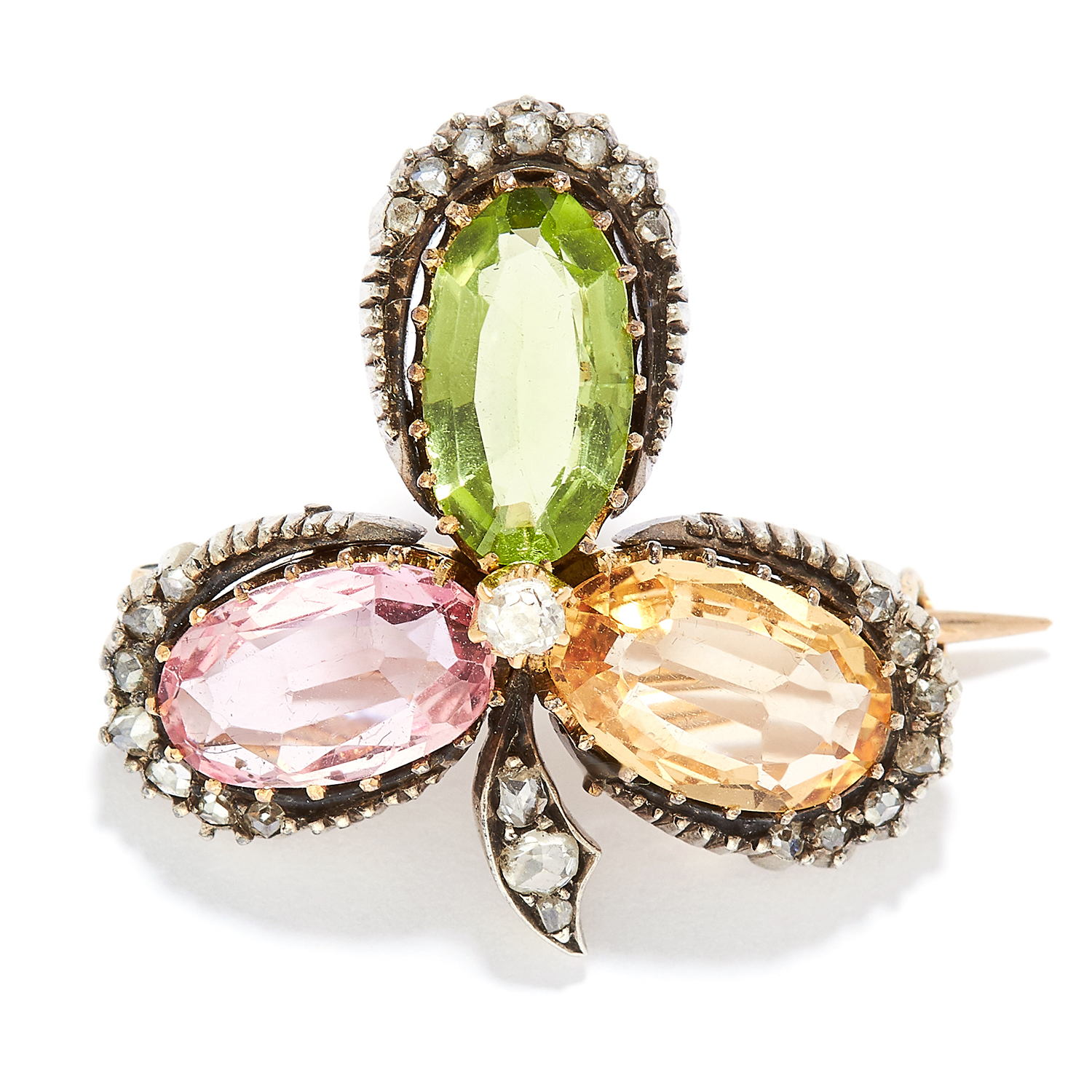 ANTIQUE PERIDOT, TOPAZ AND DIAMOND CLOVER BROOCH in yellow gold, set with an oval cut peridot,