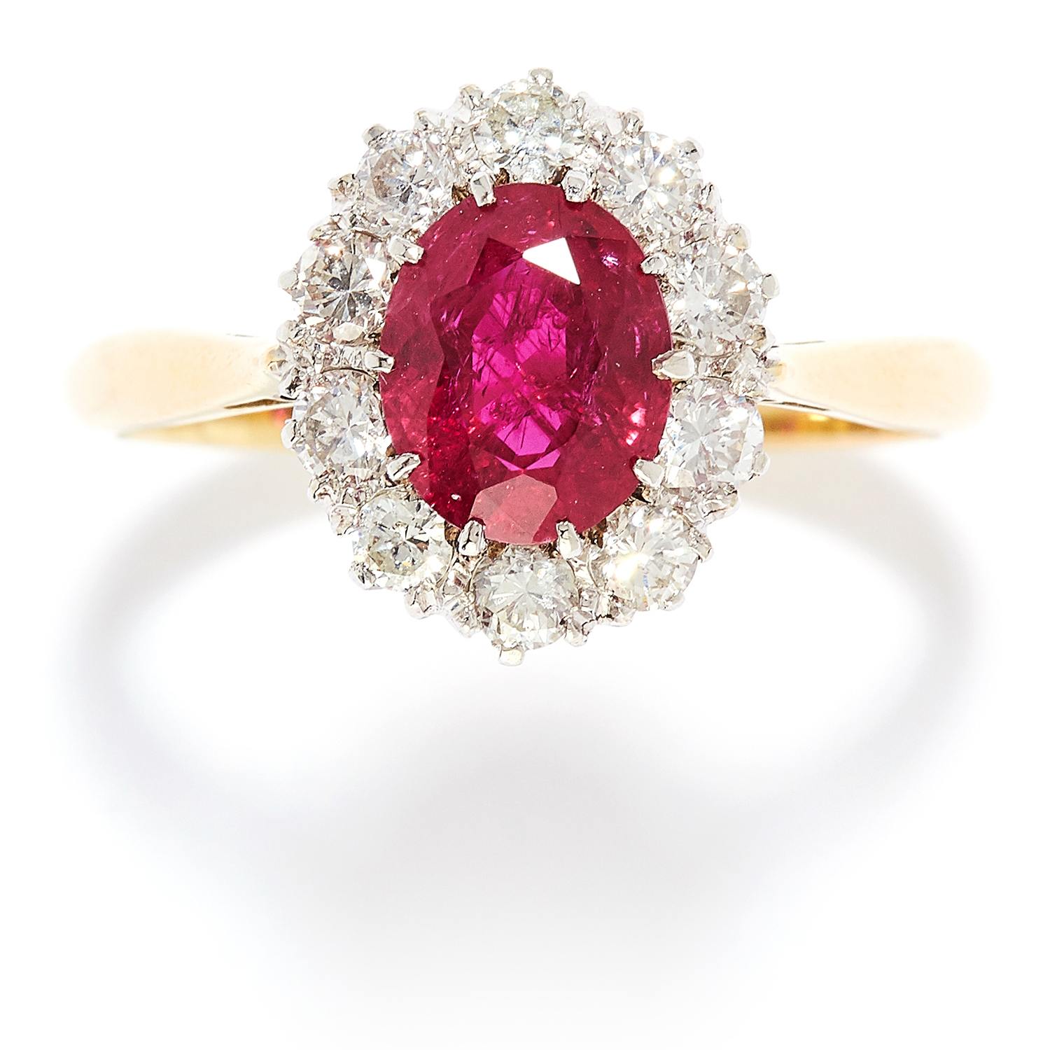 1.20 CARAT RUBY AND DIAMOND CLUSTER RING in 18ct yellow gold, set with a oval cut ruby of