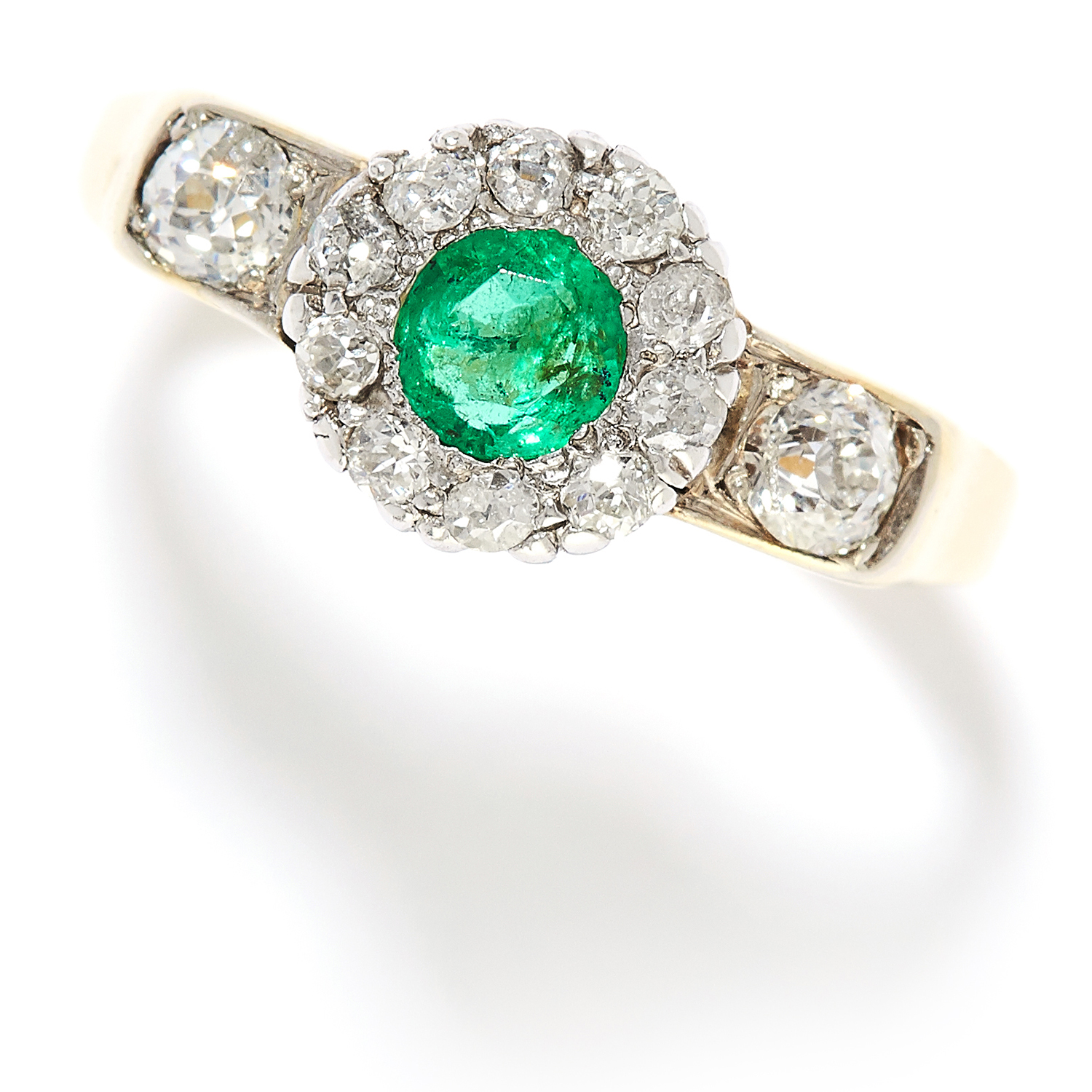 0.85 CARAT EMERALD AND DIAMOND RING in yellow gold, set with a round cut emerald of approximately
