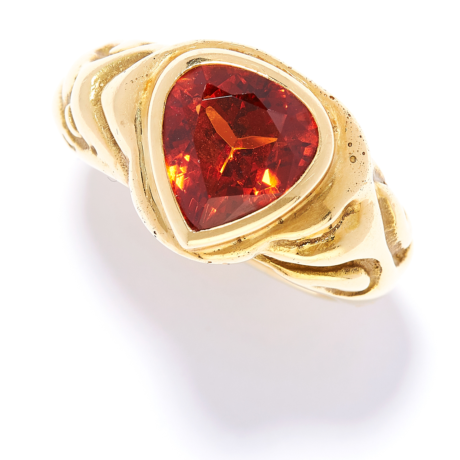 SPESSARTITE GARNET DRESS RING, ELIZABETH GAGE, 1989 in 18ct yellow gold, set with a pear cut