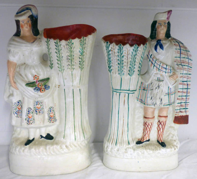 Lot 3014 - PAIR OF STAFFORDSHIRE POTTERY FIGURAL VASES OF HIGHLAND COUPLE - 34CM TALL