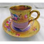 EARLY 20TH CENTURY LILAC & GILT CABINET CUP & SAUCER WITH FLORAL DECORATION SIGNED E.