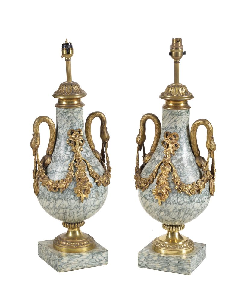 Lot 34 - A pair of French marmo cipollino and gilt bronze mounted table lamps in Louis XVI taste