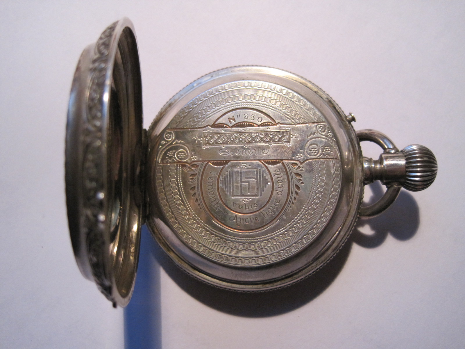 Lot 12 - Large pocket watch in sterling silver nineteenth, richly engraved case, partially [...]