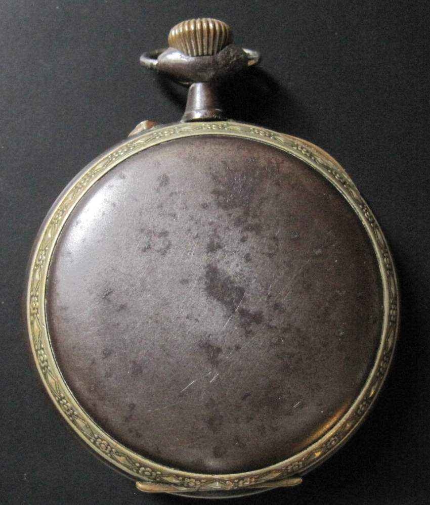 Lot 2 - Large pocket watch in steel and partially gilded brass, enamelled dial, brand [...]