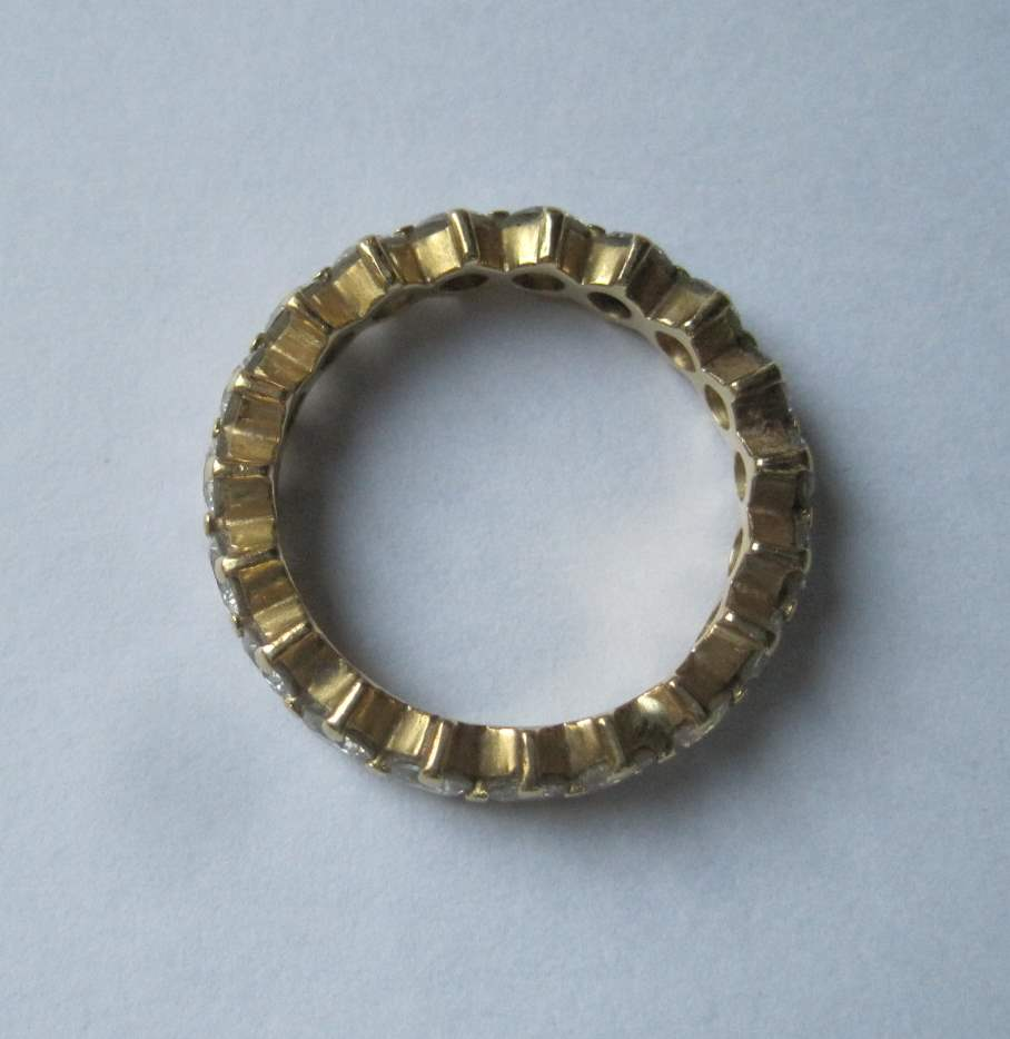 Lot 46 - Yellow gold American wedding ring with 19 diamonds, totaling approximately 1.70 ct - [...]