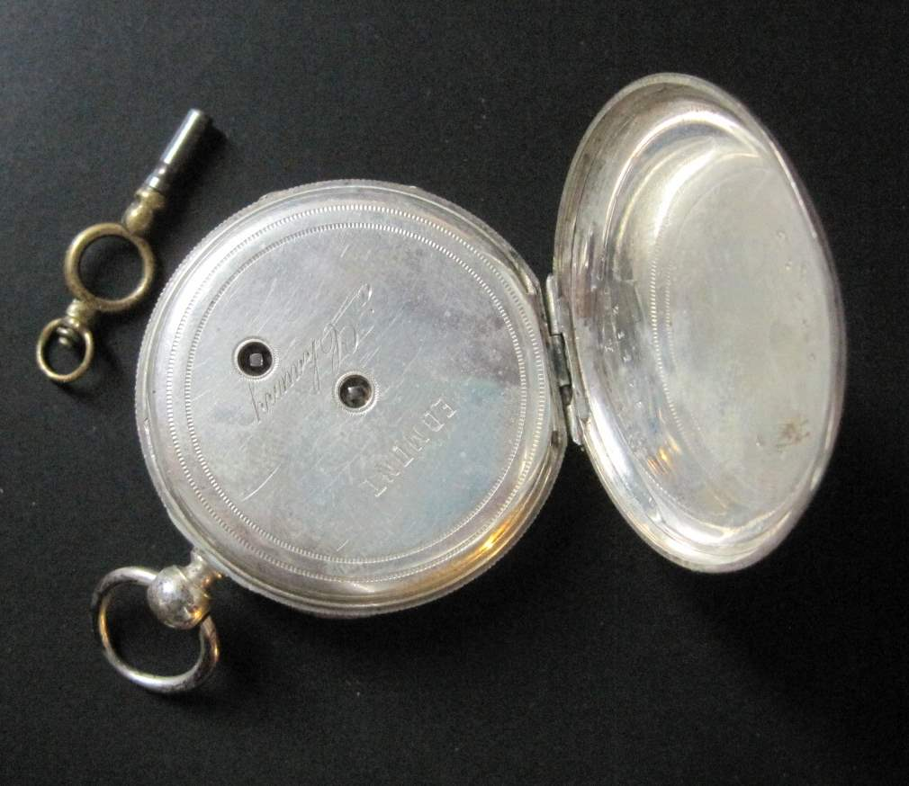 Lot 6 - Pocket watch with key, in solid silver, Edmont in Schauny, back finely engraved, end [...]