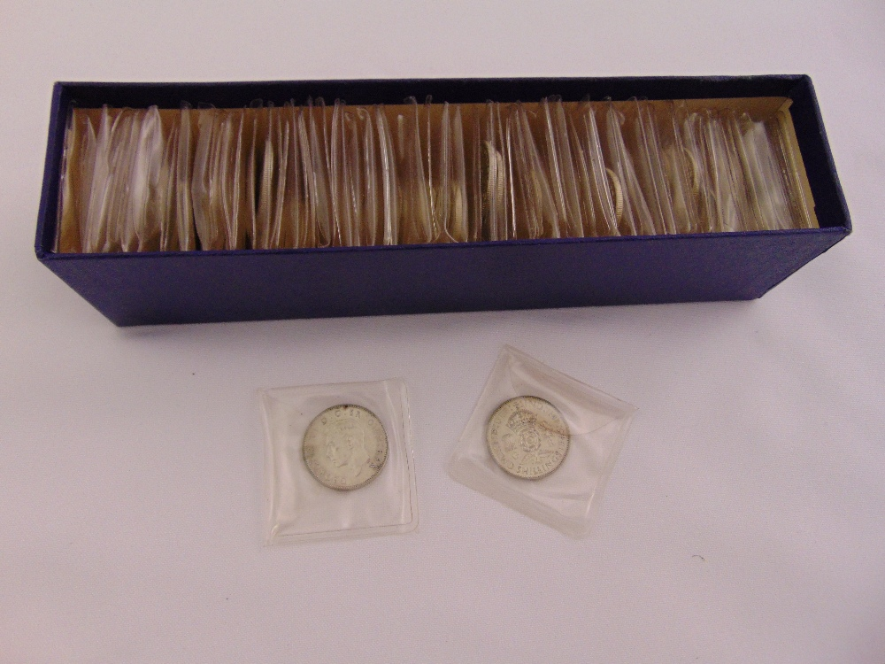 Seventy 1945 George VI florins all in individual plastic sleeves, approx total weight of coins 791g