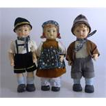 3 Bisquitporzellan Puppen im Stil der Hummelfiguren, h. je 25cm- - -18.00 % buyer's premium on the
