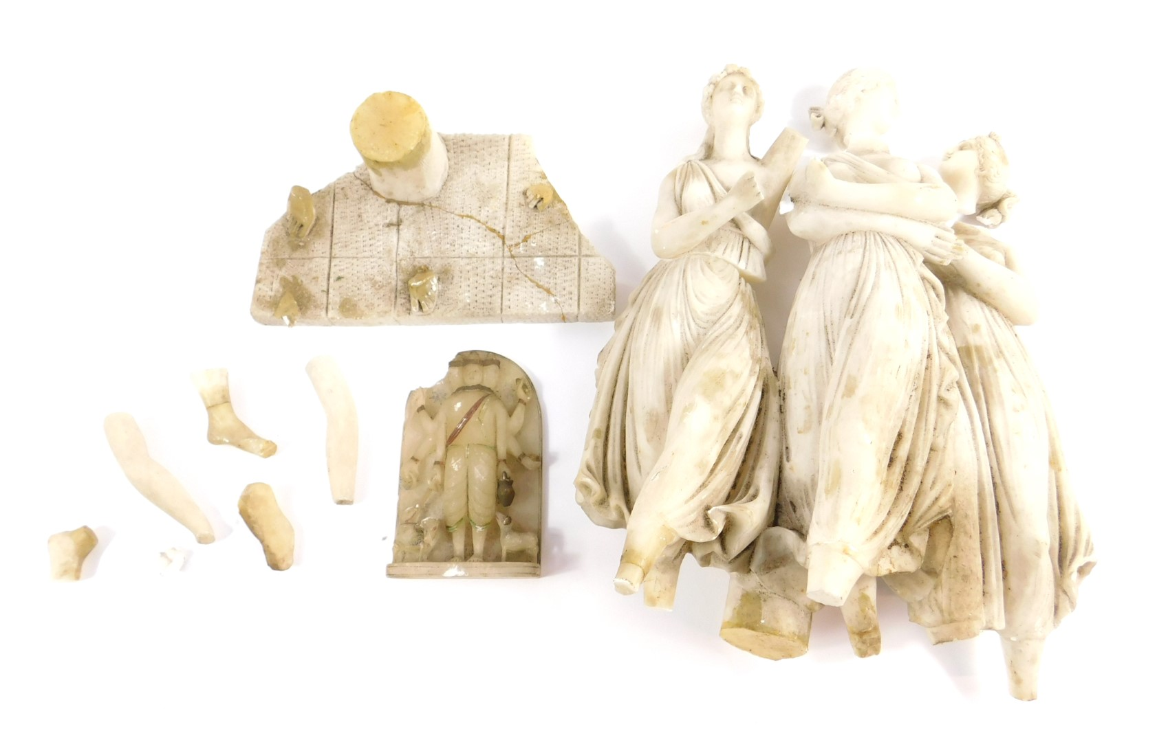A Continental alabaster figure group modelled as The Three Graces, and an Asian alabaster deity