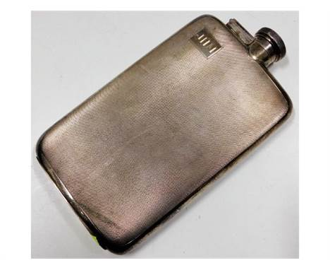 A large silver hip flask approx. 7.5in tall, 323.5g, monogrammed with initials JHM