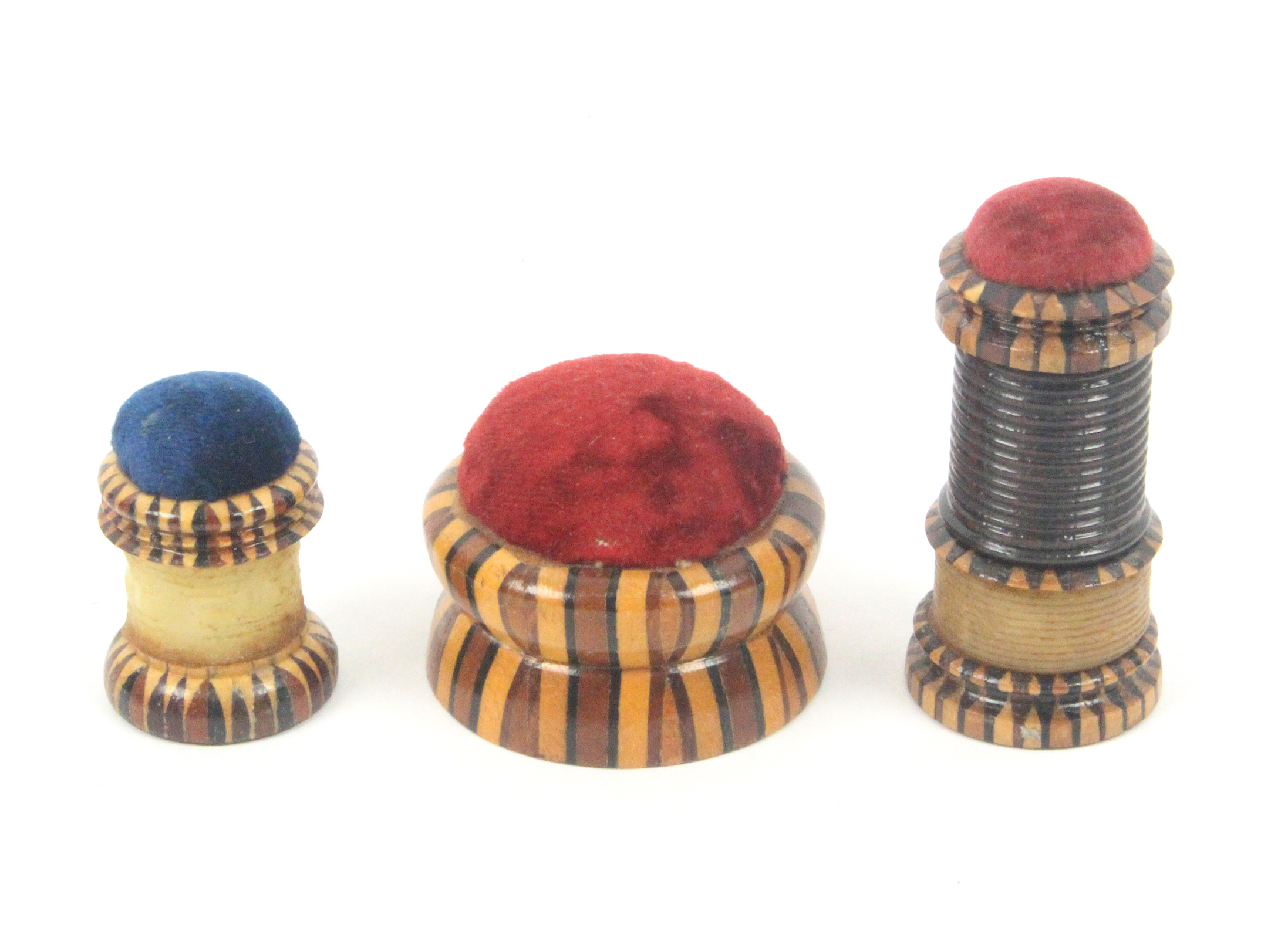 Lot 46 - Tunbridge ware - sewing - three pieces, comprising a combination waxer/tape measure/pin cushion in