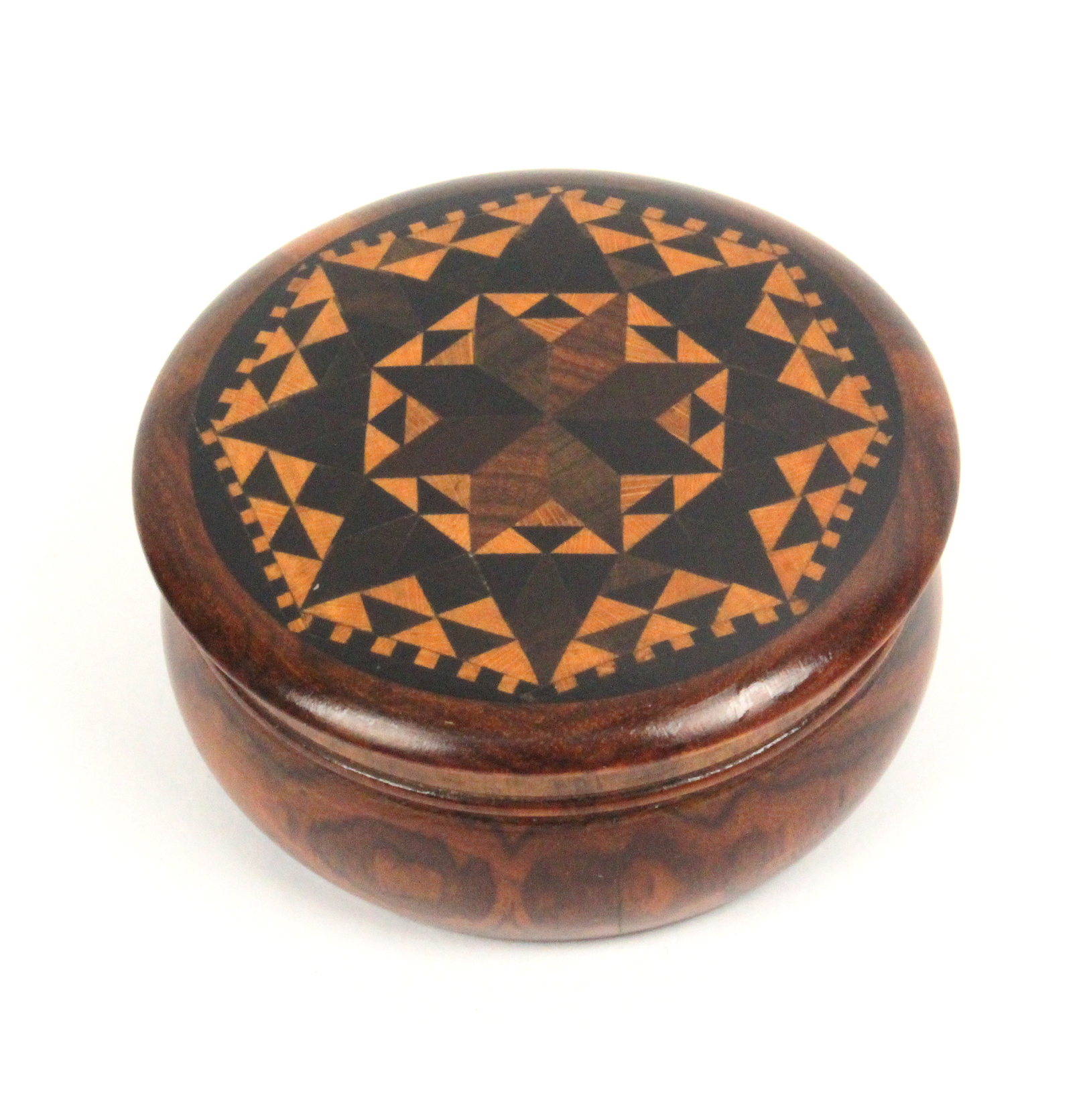 Lot 13 - A well turned rosewood circular Tunbridge ware box, the over hanging lid in geometric stickware, 6cm