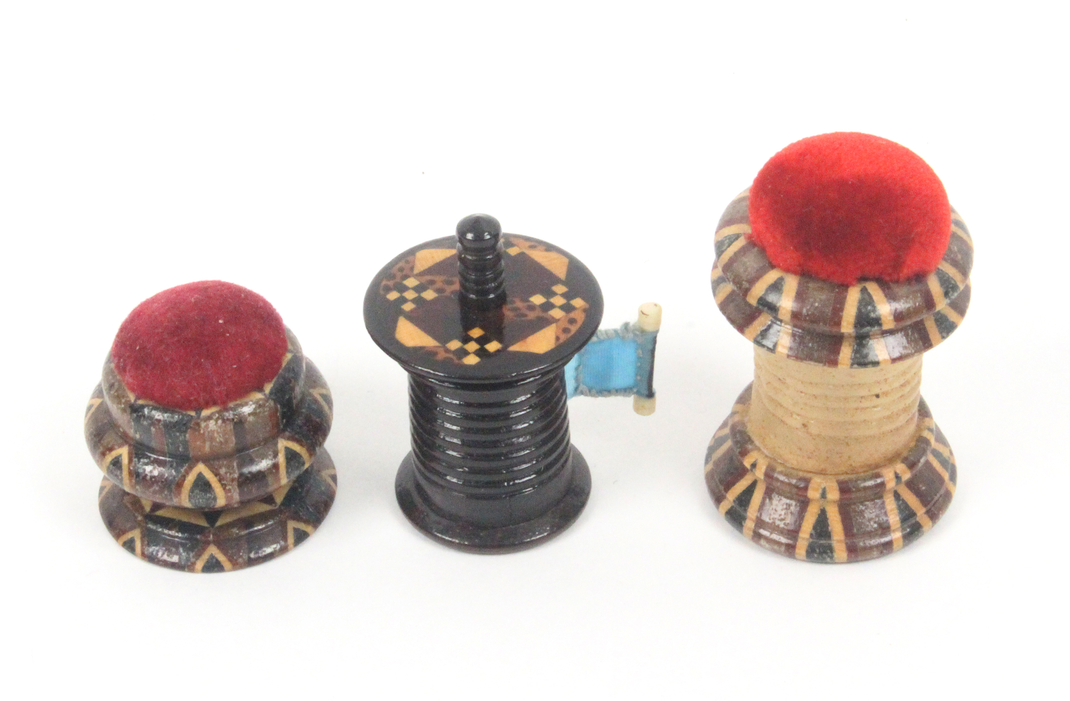 Lot 47 - Tunbridge ware - sewing - three pieces, comprising a rosewood cylinder tape measure with overhanging