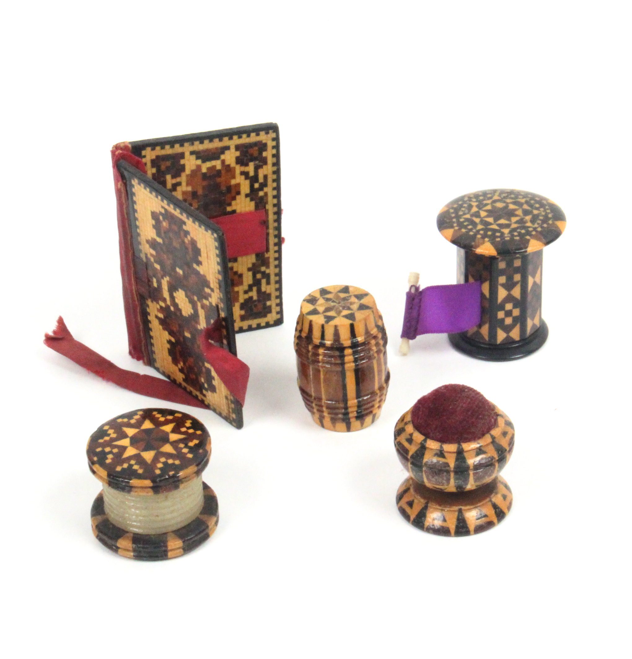 Lot 16 - Tunbridge ware - sewing - five pieces comprising an attractive stick ware tape measure with over