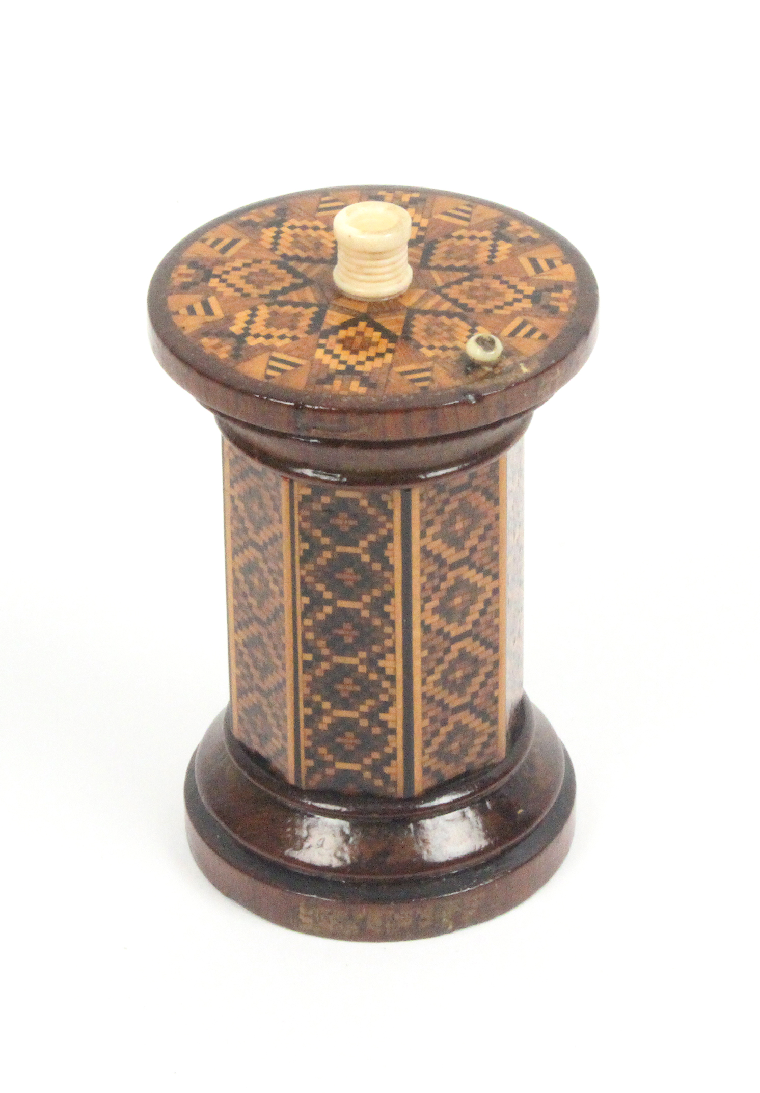 Lot 12 - A Tunbridge ware rosewood go-to-bed, the octagonal body in panels of geometric mosaic, the turned