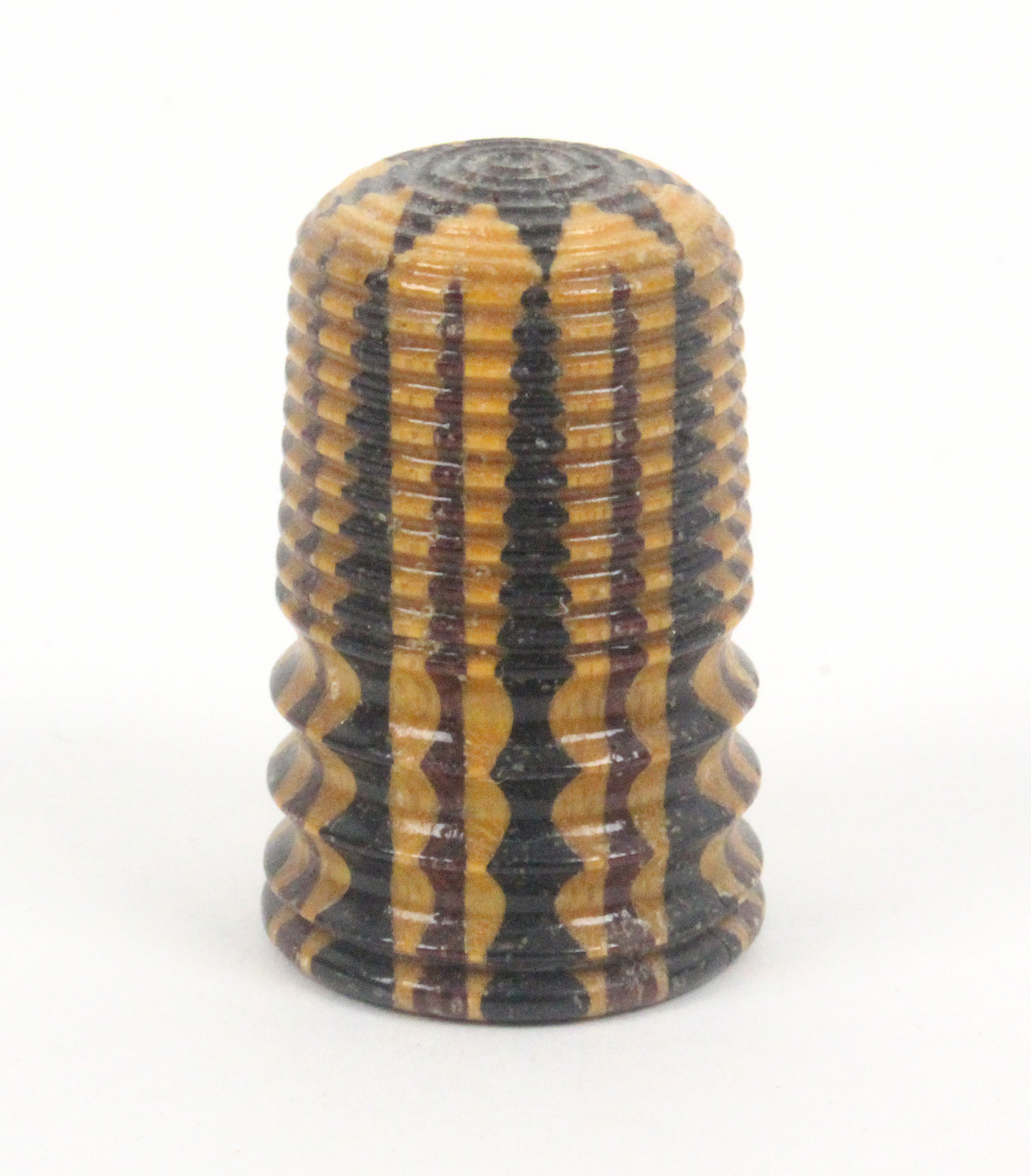 Lot 28 - A rare 19th Century Tunbridge stickware thimble - star roundel turned top, triple concave frieze