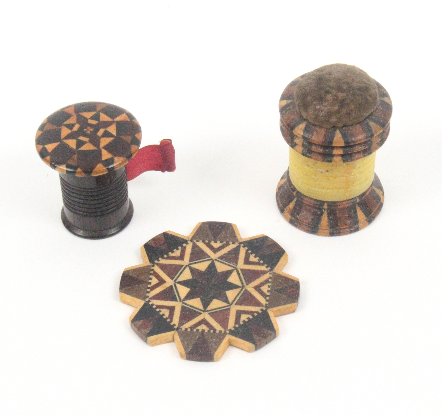 Lot 45 - Tunbridge ware - sewing - three pieces, comprising a cylinder form combination pin cushion/waxer
