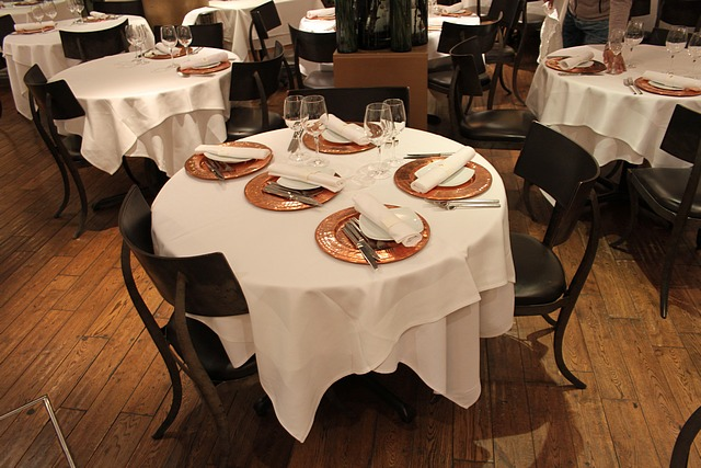 Lot 10 - Restaurant dining table round mounted on cast base 1050mm diameter x 740mm complete with 3 x