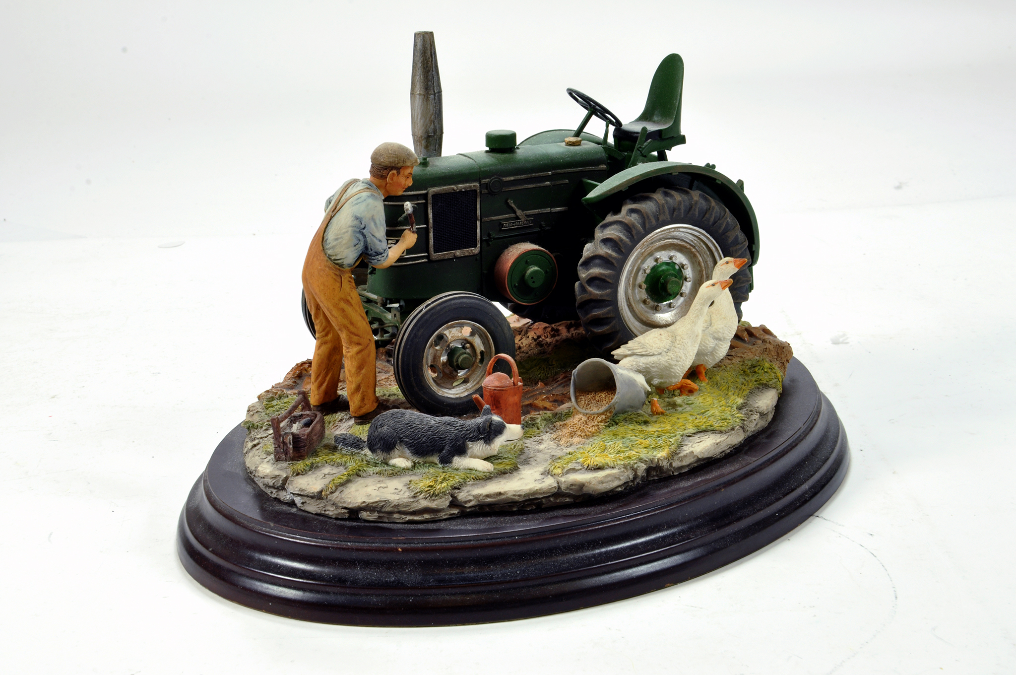 Lot 803 - A static presentation piece comprising a Country Artists model featuring a Field Marshall Tractor.