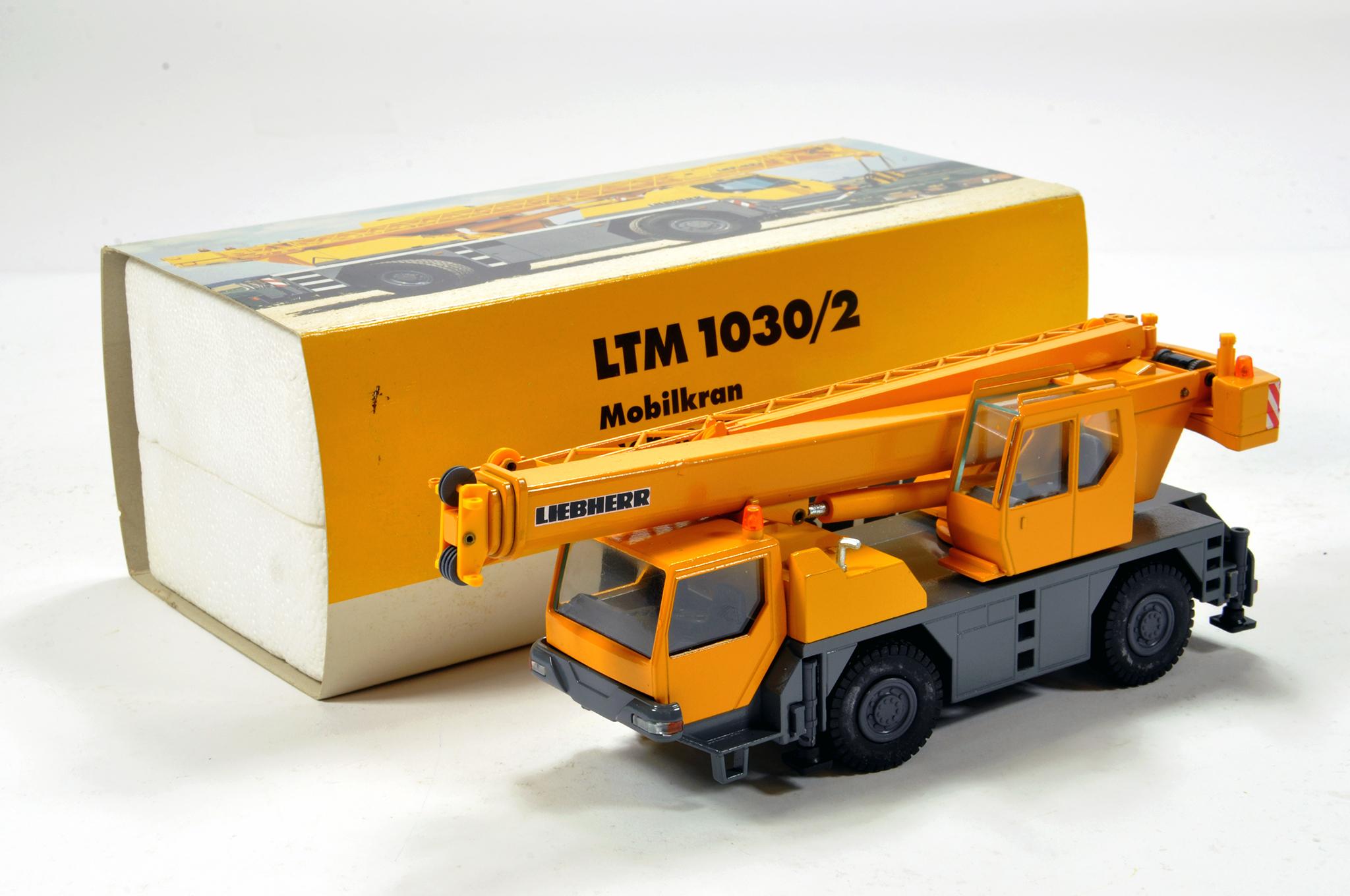 Lot 352 - Conrad 1/50 construction issue comprising Liebherr LTM 1030/2 Mobile Crane. E to NM.