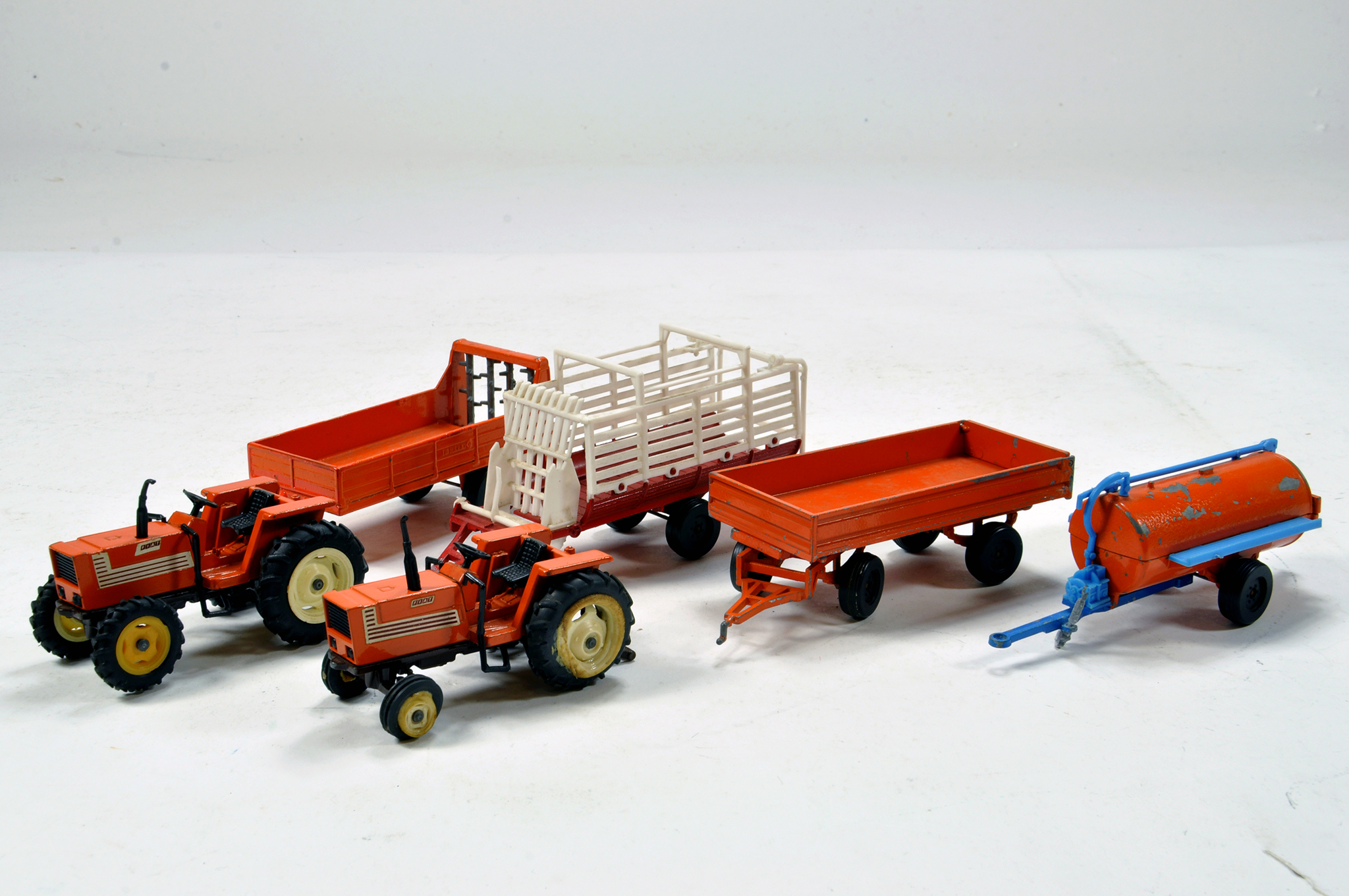 Lot 892 - A group of Forma-Toys 1/43 Farm Issues comprising Fiat Tractor and Implement combinations. Generally
