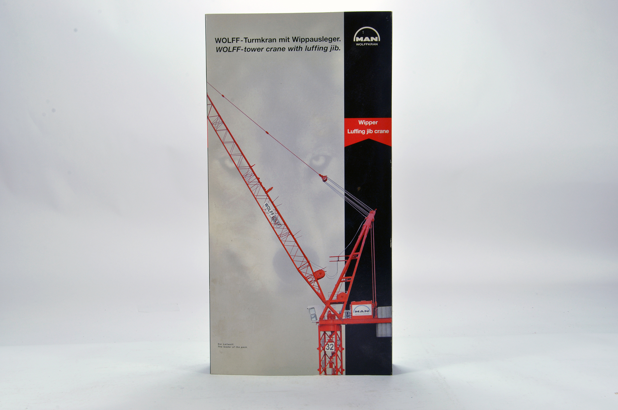 Lot 355 - Conrad 1/87 construction issue comprising MAN Wolfkran Luffing Jib Tower Crane. E to NM.