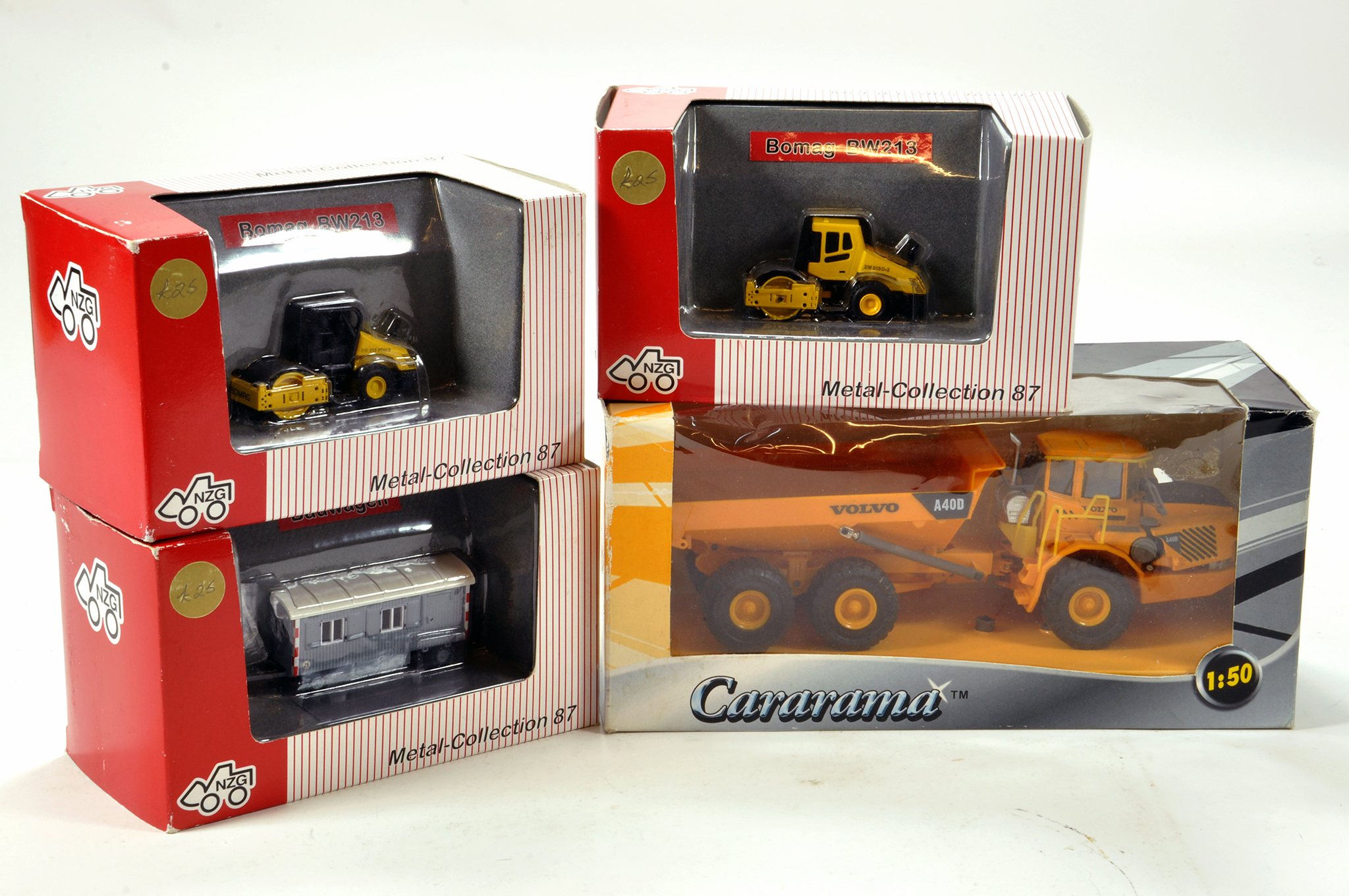 Lot 654 - Assorted Construction diecast issues from NZG and one other. E to NM in Boxes. (4)