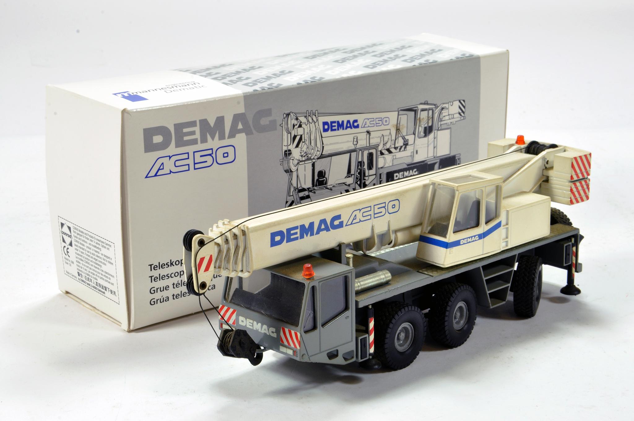 Lot 350 - Conrad 1/50 construction issue comprising Demag AC50 Mobile Crane. E to NM.