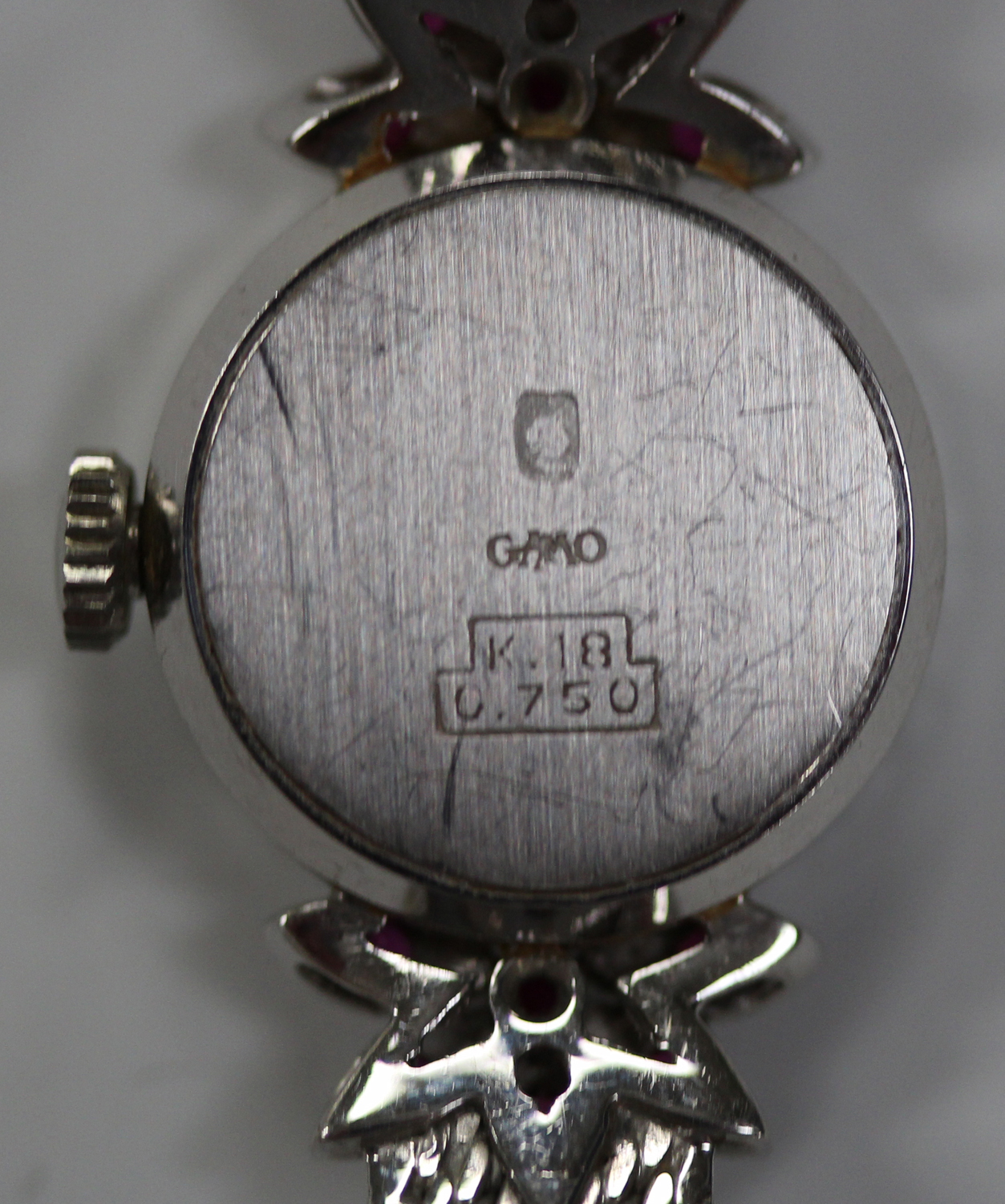 Lot 1010 - A white gold, diamond and synthetic ruby lady's bracelet wristwatch, the silvered dial with baton